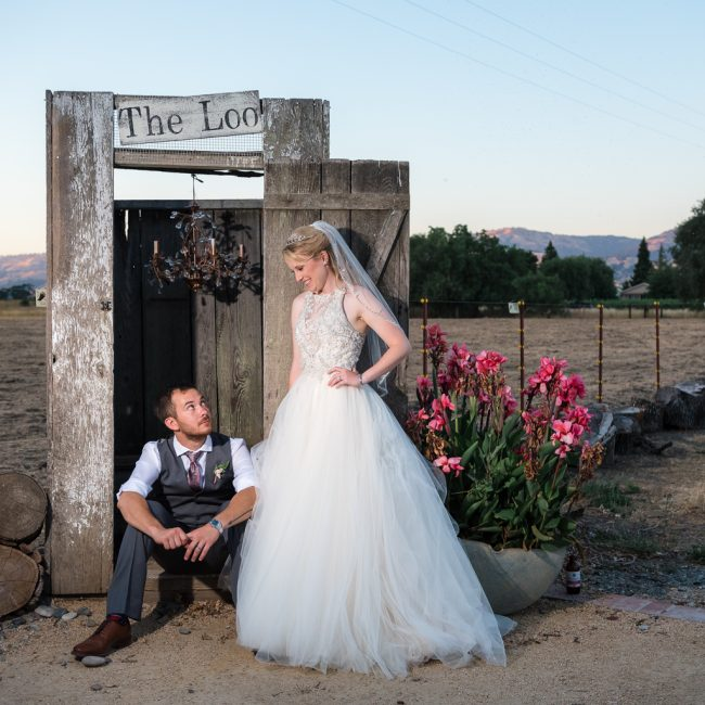 A bride and groom sit by the loo at the Fitz Place wedding venue.