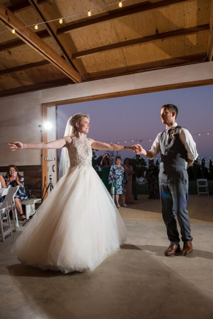 Newlywed bride and groom dance together at their Fitz Place wedding reception.