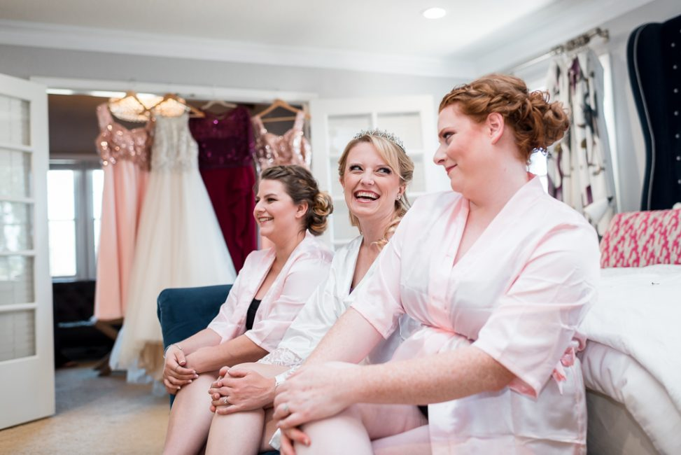 A bride and her bridesmaids relax before the ceremony.