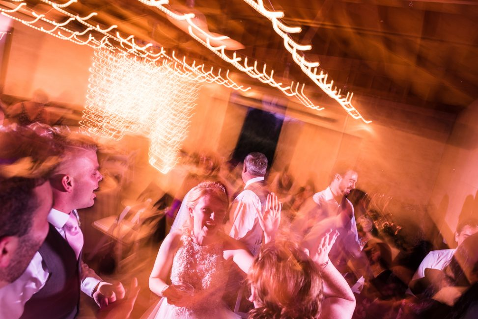 Guests join the dance floor with long exposure images of wedding dancing.