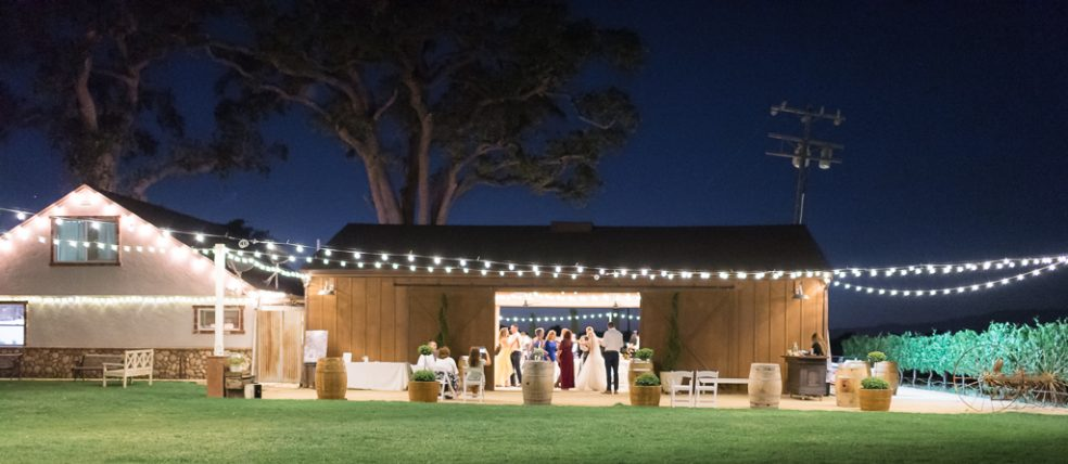 Outdoor nighttime photograph of a wedding reception at the Fitz Place.
