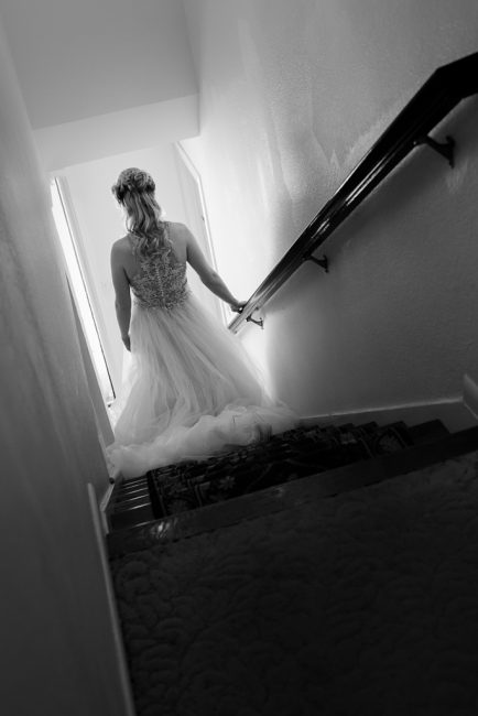 A bride descends a staircase
