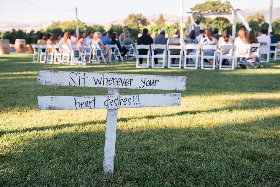 A sign directs wedding guests where to sit at the Fitz Place in San Martin, California.