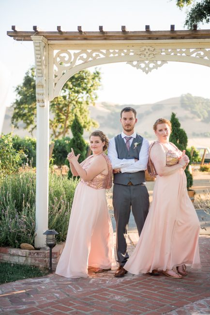 The bridesmaids play Charlie's Angels to the new groom.