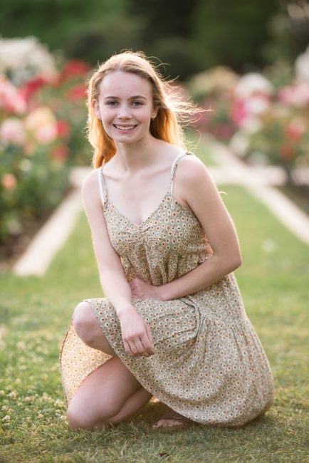 Senior Portrait of a young woman in a Northern California rose garden.
