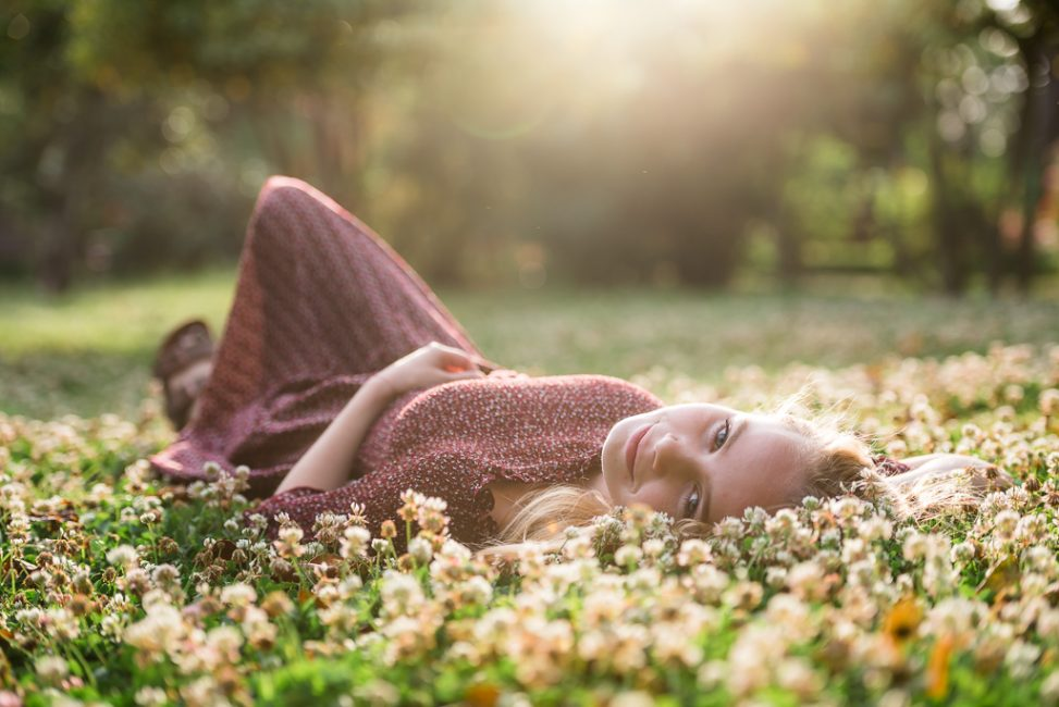 Senior Portraits of young girl laying on the grass