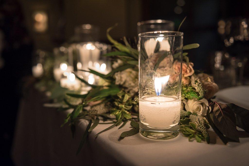 Close up of a bridal table at a wedding reception.
