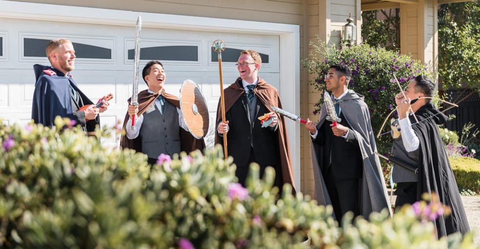 The groomsmen dress up to play door games at a true gamer's wedding